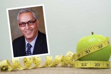 Dr. John Yadegar's headshot with an apple wrapped in a tape measure